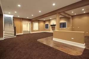 Empty living room with brown carpet