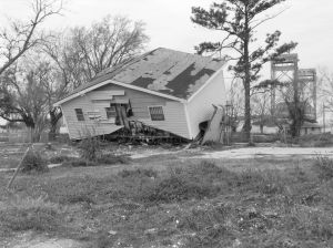 Black and white image of damaged house due to flooding